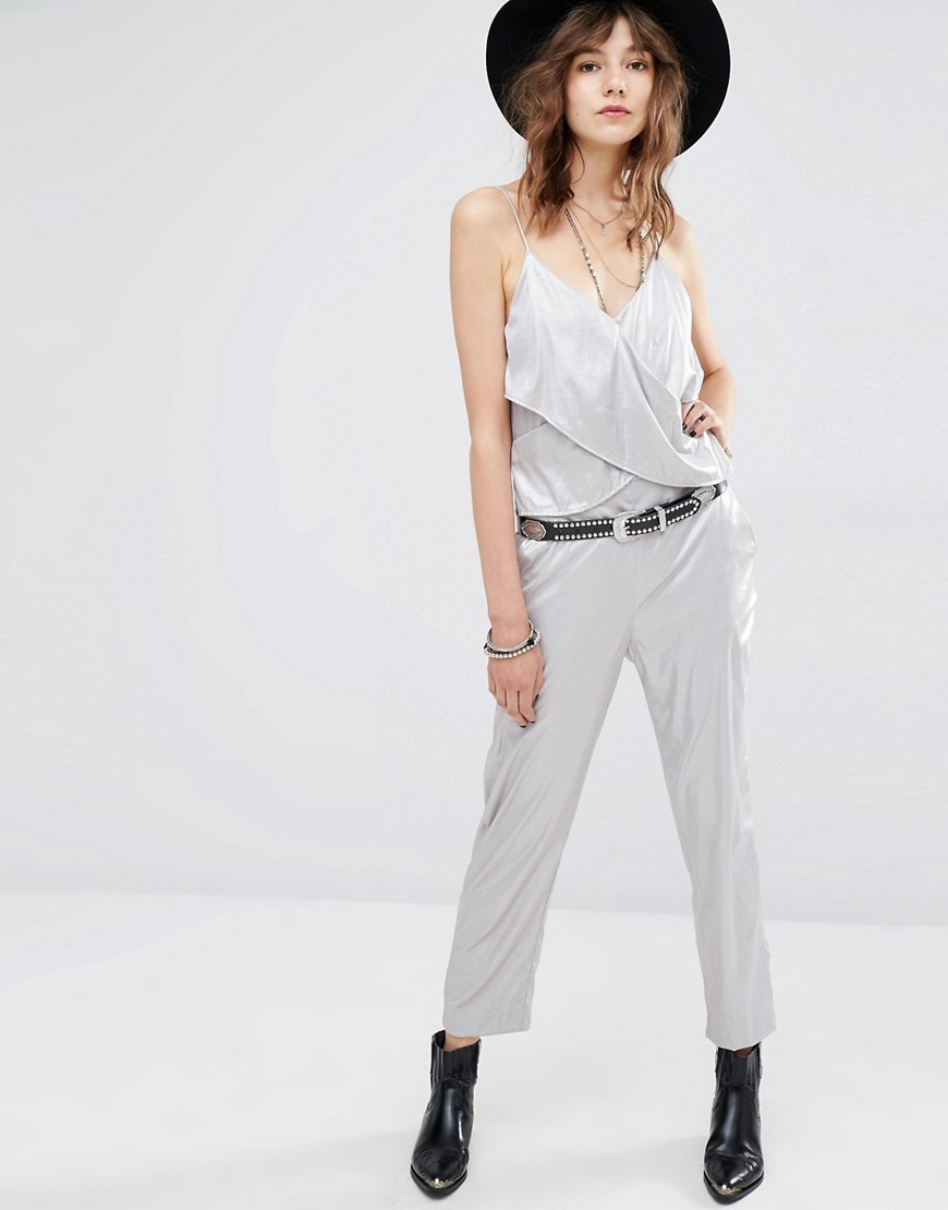 Silver Festival Jumpsuit Silver - length: standard; neckline: v-neck; fit: fitted at waist; pattern: plain; sleeve style: sleeveless; predominant colour: light grey; fibres: polyester/polyamide - 100%; occasions: occasion; sleeve length: sleeveless; style: jumpsuit; pattern type: fabric; texture group: other - light to midweight; season: s/s 2016; wardrobe: event