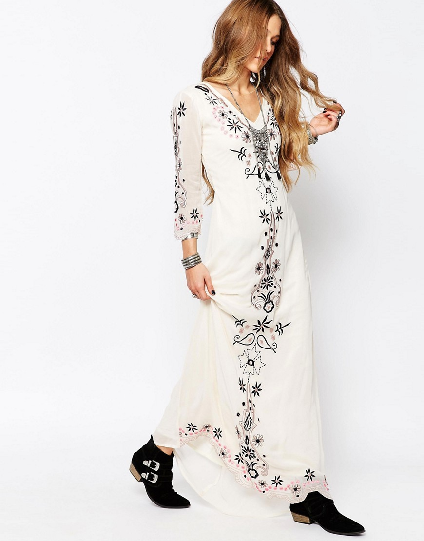 Festival Maxi Dress Cream - neckline: v-neck; style: maxi dress; predominant colour: ivory/cream; secondary colour: black; occasions: evening; length: floor length; fit: body skimming; fibres: viscose/rayon - 100%; sleeve length: 3/4 length; sleeve style: standard; texture group: sheer fabrics/chiffon/organza etc.; pattern type: fabric; pattern: florals; season: s/s 2016; wardrobe: event