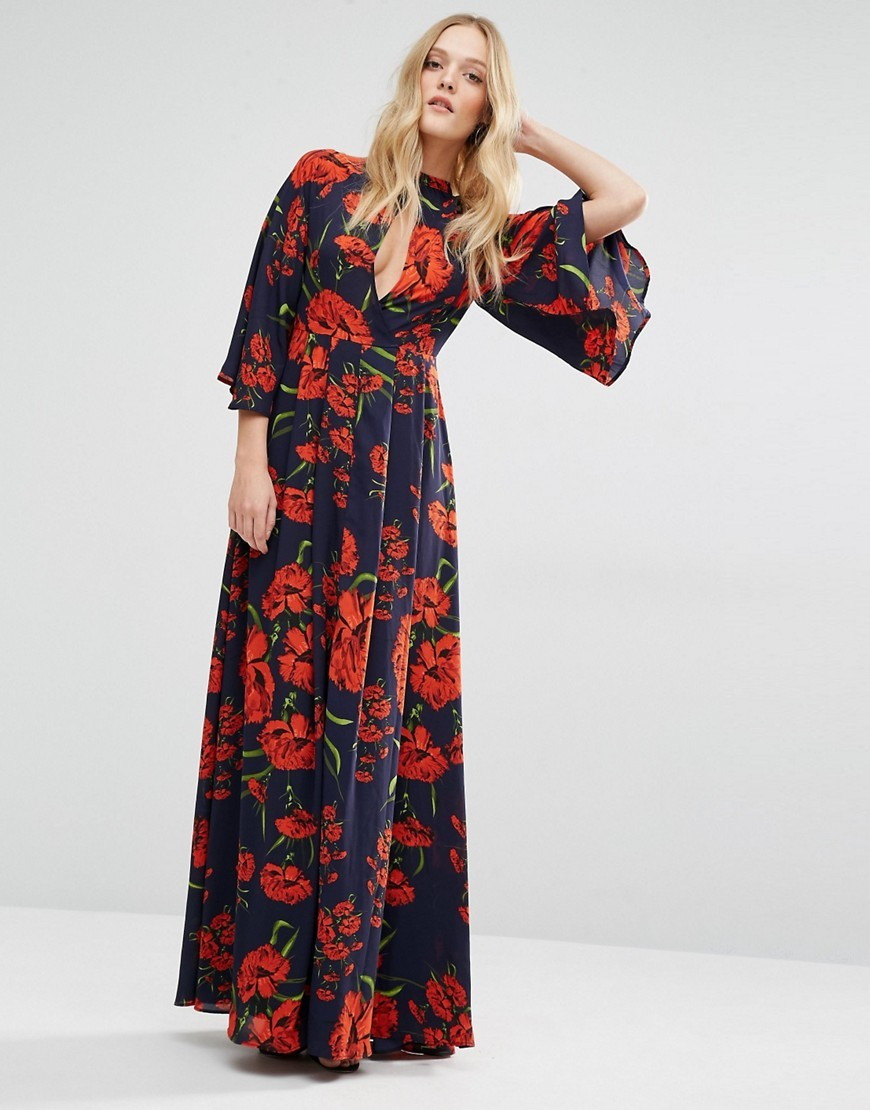 Nehmat Queen Maxi Dress With Kimono Sleeve All Over Print - style: maxi dress; sleeve style: kimono; secondary colour: true red; predominant colour: navy; occasions: evening; length: floor length; fit: body skimming; neckline: peep hole neckline; fibres: polyester/polyamide - 100%; sleeve length: 3/4 length; pattern type: fabric; pattern: florals; texture group: jersey - stretchy/drapey; multicoloured: multicoloured; season: s/s 2016; wardrobe: event