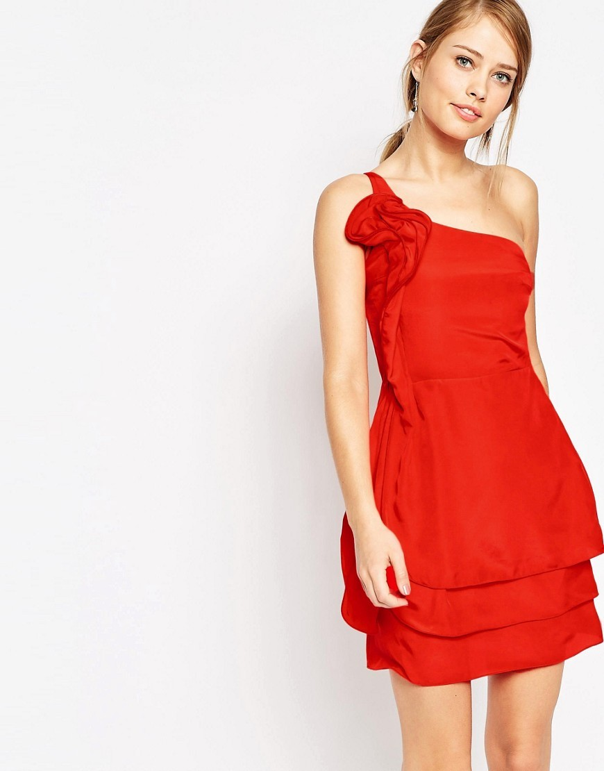 Ruffle One Shoulder Dress Red - length: mini; pattern: plain; sleeve style: sleeveless; style: asymmetric (top); neckline: asymmetric; predominant colour: true red; occasions: evening; fit: body skimming; fibres: polyester/polyamide - 100%; hip detail: adds bulk at the hips; sleeve length: sleeveless; pattern type: fabric; texture group: other - light to midweight; season: s/s 2016; wardrobe: event; embellishment: frills; embellishment location: bust