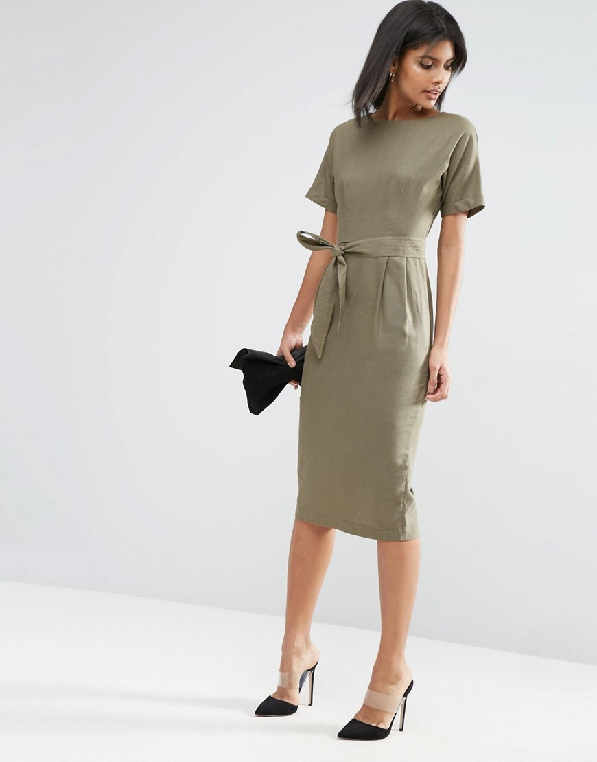 Belted Wiggle Dress In Linen Khaki - style: shift; length: below the knee; pattern: plain; waist detail: belted waist/tie at waist/drawstring; predominant colour: khaki; occasions: evening; fit: body skimming; fibres: linen - 100%; neckline: crew; sleeve length: short sleeve; sleeve style: standard; texture group: linen; pattern type: fabric; season: s/s 2016