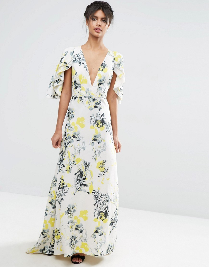 Ruffle Cape Deep Plunge Floral Maxi Dress Multi - neckline: low v-neck; sleeve style: angel/waterfall; style: maxi dress; predominant colour: white; secondary colour: yellow; occasions: evening; length: floor length; fit: body skimming; fibres: polyester/polyamide - 100%; sleeve length: short sleeve; texture group: sheer fabrics/chiffon/organza etc.; pattern type: fabric; pattern: florals; multicoloured: multicoloured; season: s/s 2016; wardrobe: event