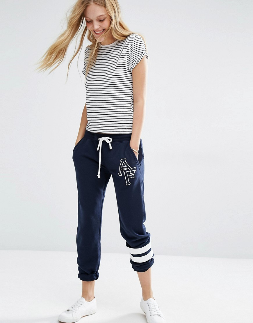 Drawstring Sweatpant With Logo Navy - length: standard; style: tracksuit pants; waist: mid/regular rise; predominant colour: navy; occasions: casual; fibres: cotton - mix; fit: tapered; pattern type: fabric; texture group: jersey - stretchy/drapey; pattern: horizontal stripes (bottom); season: s/s 2016