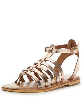 Gladiator Sandals - predominant colour: gold; occasions: casual, holiday; material: faux leather; heel height: flat; ankle detail: ankle strap; heel: standard; toe: open toe/peeptoe; style: gladiators; finish: metallic; pattern: plain; season: s/s 2016; wardrobe: basic