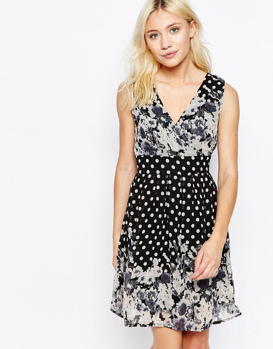Sleeveless V Neck Skater Dress In Border Print Black - neckline: v-neck; sleeve style: sleeveless; secondary colour: white; predominant colour: black; occasions: evening; length: just above the knee; fit: fitted at waist & bust; style: fit & flare; fibres: polyester/polyamide - 100%; sleeve length: sleeveless; pattern type: fabric; pattern: florals; texture group: other - light to midweight; multicoloured: multicoloured; season: s/s 2016; wardrobe: event