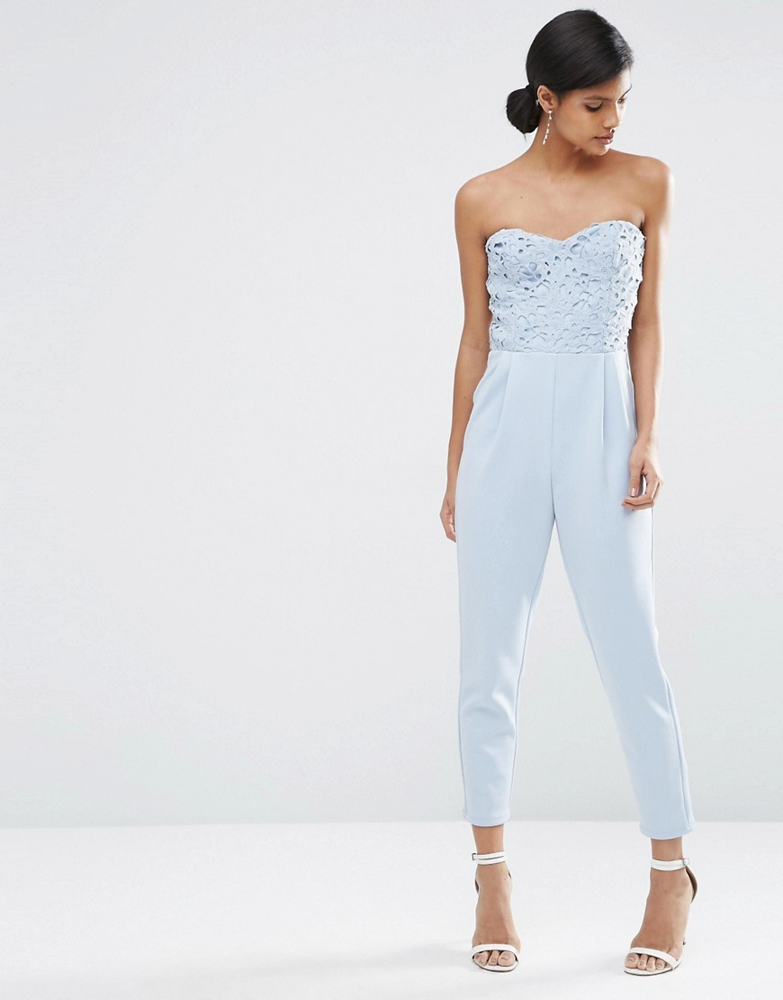Lace Bandeau Peg Leg Jersey Jumpsuit Blue - neckline: strapless (straight/sweetheart); fit: tailored/fitted; sleeve style: strapless; bust detail: subtle bust detail; predominant colour: pale blue; occasions: evening; length: ankle length; fibres: polyester/polyamide - 100%; sleeve length: sleeveless; style: jumpsuit; pattern type: fabric; pattern size: light/subtle; pattern: patterned/print; texture group: jersey - stretchy/drapey; embellishment: lace; season: s/s 2016; wardrobe: event; embellishment location: bust