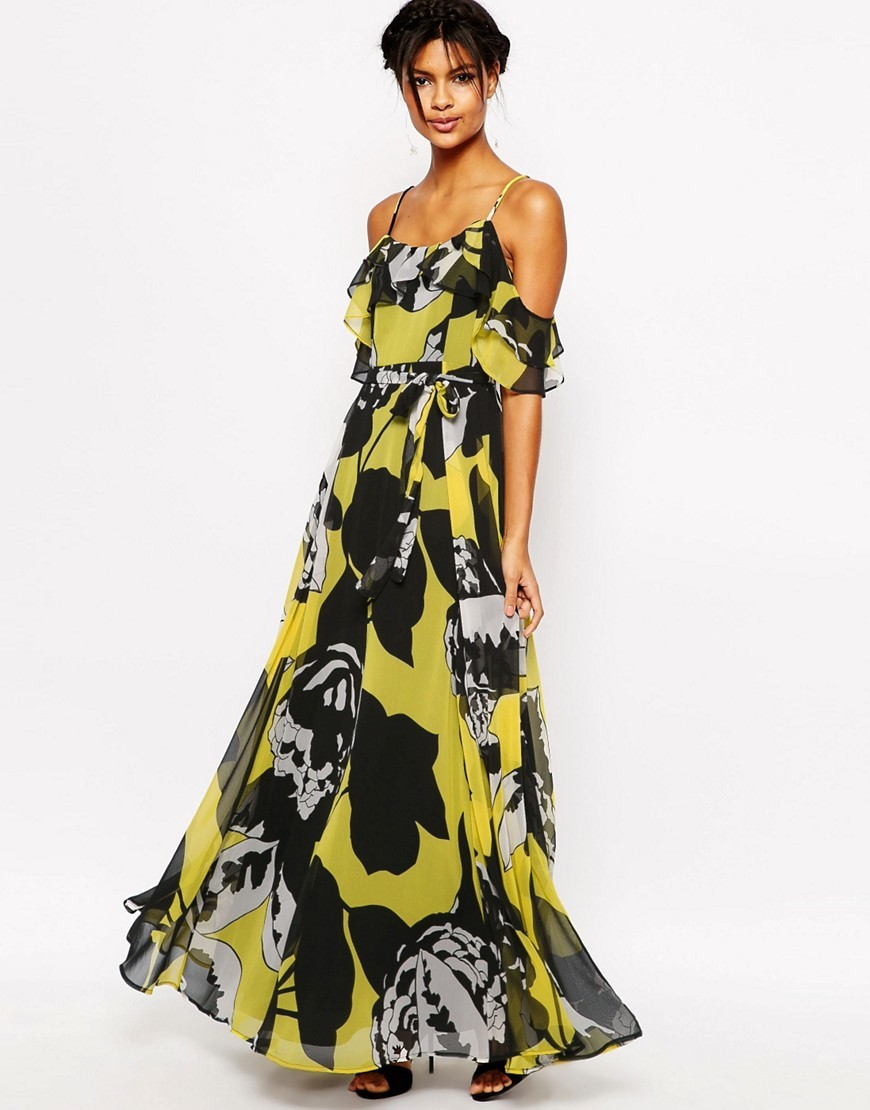 Ruffle Cami Maxi Dress In Yellow And Black Floral Multi - fit: loose; style: maxi dress; predominant colour: yellow; secondary colour: black; occasions: evening; length: floor length; neckline: scoop; fibres: polyester/polyamide - 100%; shoulder detail: cut out shoulder; sleeve length: half sleeve; sleeve style: standard; pattern type: fabric; pattern: florals; texture group: other - light to midweight; multicoloured: multicoloured; season: s/s 2016; wardrobe: event