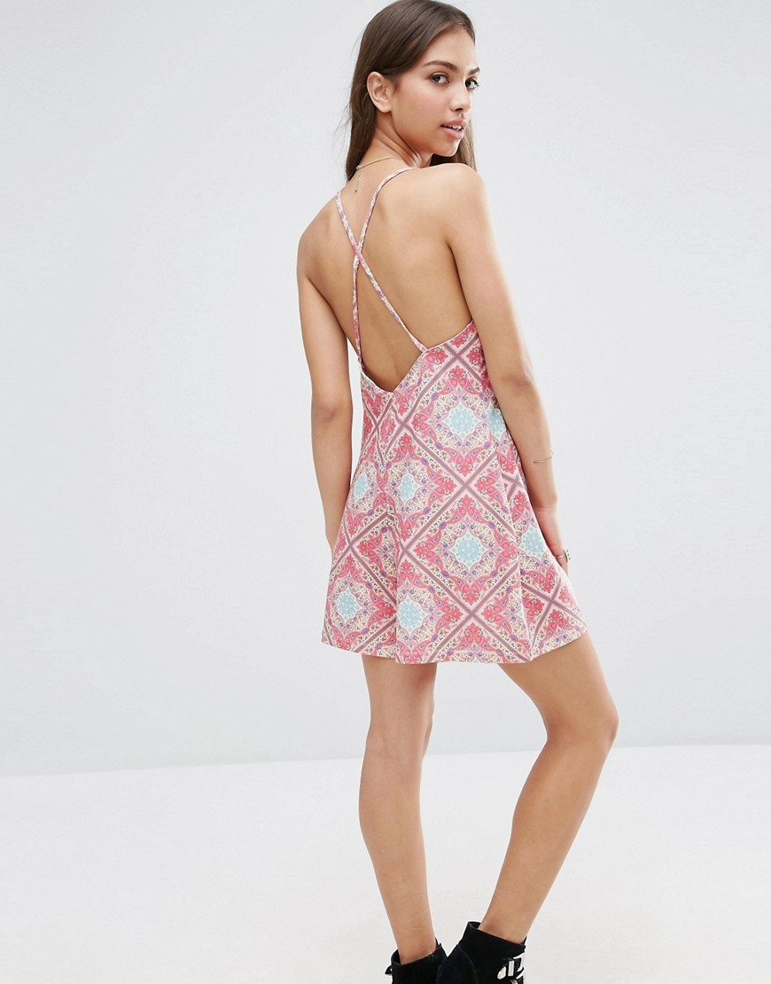 90's Festival Strappy Back Scarf Print Playsuit Multi - fit: loose; sleeve style: sleeveless; length: short shorts; secondary colour: white; predominant colour: pink; occasions: casual; fibres: polyester/polyamide - stretch; back detail: crossover; sleeve length: sleeveless; style: playsuit; neckline: medium square neck; pattern type: fabric; pattern: patterned/print; texture group: jersey - stretchy/drapey; multicoloured: multicoloured; season: s/s 2016; wardrobe: highlight