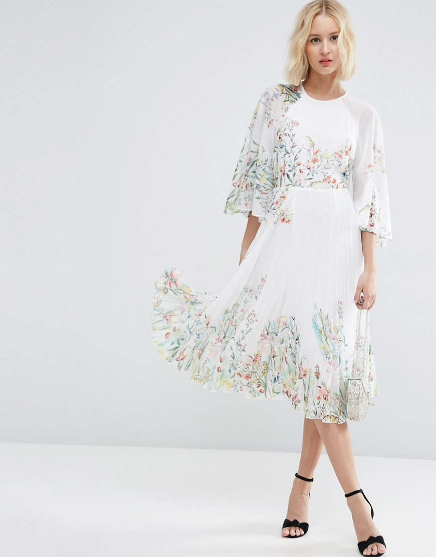 Kaftan Pleated Midi Dress In Meadow Floral Multi - style: shift; length: below the knee; predominant colour: ivory/cream; secondary colour: pistachio; fit: soft a-line; fibres: polyester/polyamide - 100%; occasions: occasion; neckline: crew; sleeve length: 3/4 length; sleeve style: standard; texture group: crepes; pattern type: fabric; pattern size: light/subtle; pattern: florals; season: s/s 2016; wardrobe: event
