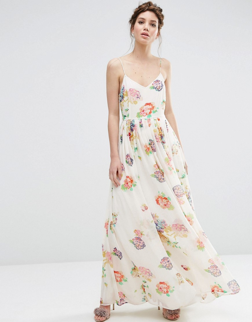 Strappy Pleated Maxi Dress In Floral Print Cream - neckline: low v-neck; sleeve style: spaghetti straps; style: maxi dress; predominant colour: ivory/cream; secondary colour: blush; occasions: evening; length: floor length; fit: body skimming; fibres: polyester/polyamide - 100%; sleeve length: sleeveless; texture group: sheer fabrics/chiffon/organza etc.; pattern type: fabric; pattern: florals; multicoloured: multicoloured; season: s/s 2016; wardrobe: event
