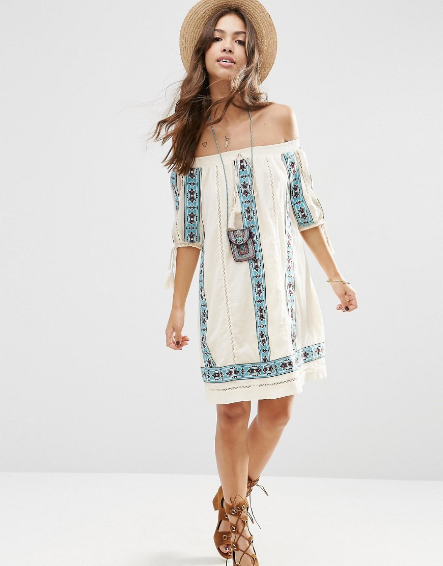 Premium Off Shoulder Swing Dress With Aztec Embroidery Cream - neckline: off the shoulder; style: sundress; predominant colour: ivory/cream; secondary colour: pale blue; occasions: casual; length: on the knee; fit: body skimming; fibres: cotton - 100%; sleeve length: half sleeve; sleeve style: standard; pattern type: fabric; pattern: patterned/print; texture group: other - light to midweight; embellishment: embroidered; multicoloured: multicoloured; season: s/s 2016; wardrobe: highlight; embellishment location: pattern