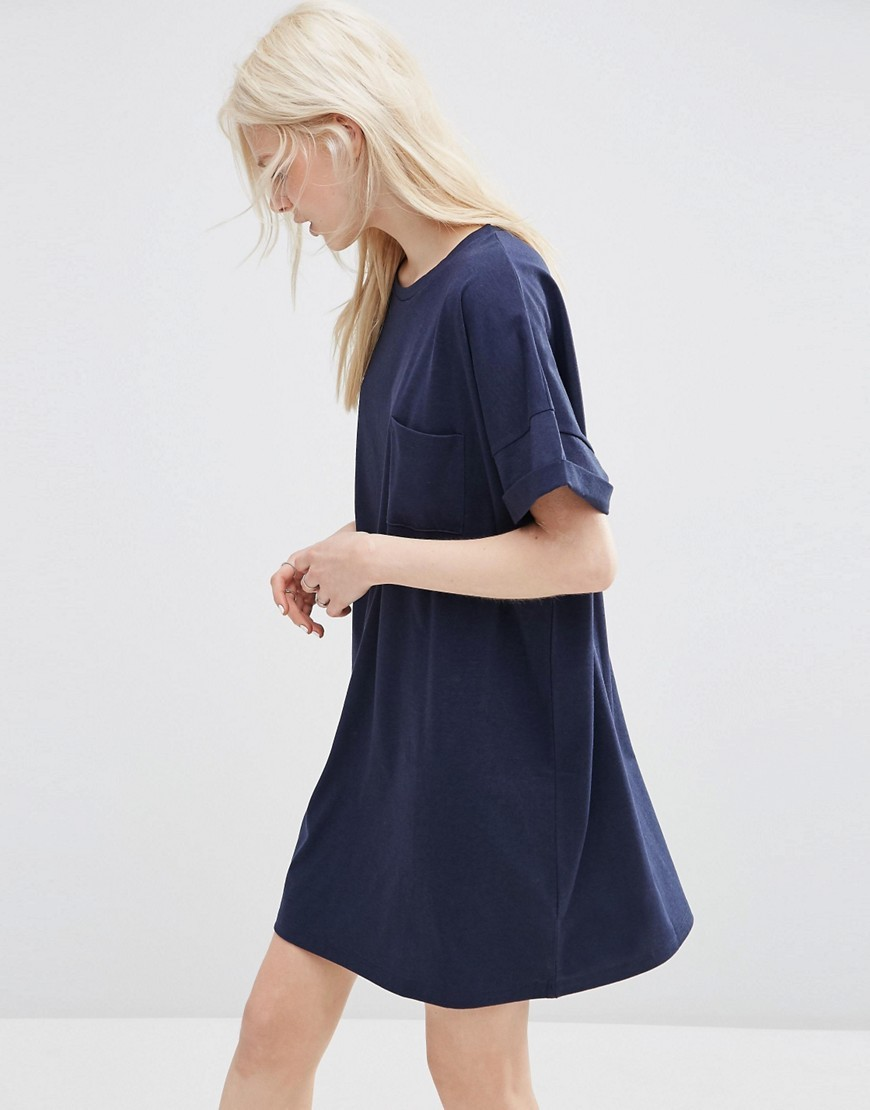Casual Oversize T Shirt Dress With Pocket Navy - style: t-shirt; fit: loose; pattern: plain; predominant colour: navy; occasions: casual; length: just above the knee; fibres: cotton - mix; neckline: crew; sleeve length: short sleeve; sleeve style: standard; pattern type: fabric; texture group: jersey - stretchy/drapey; season: s/s 2016; wardrobe: basic