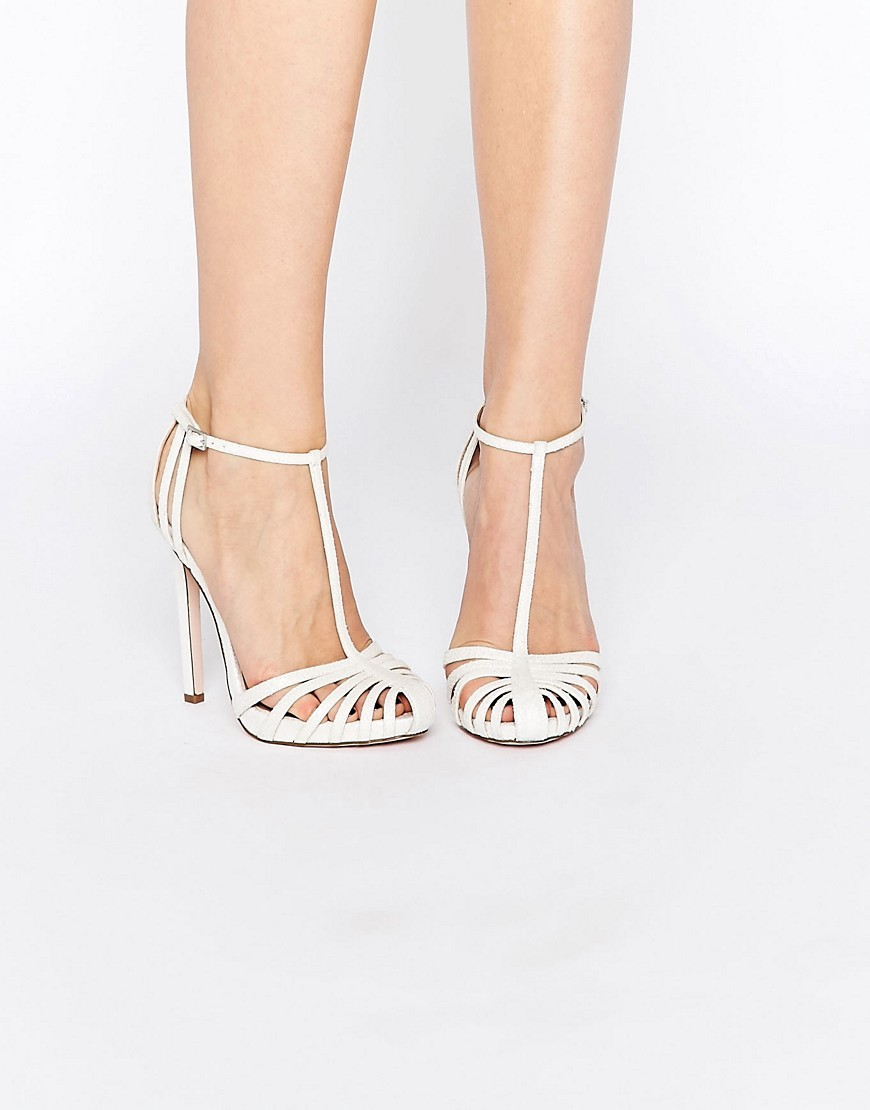 Peace Bridal Caged High Heels Ivory Snake - predominant colour: ivory/cream; occasions: evening; material: faux leather; heel height: high; ankle detail: ankle strap; heel: stiletto; toe: round toe; style: t-bar; finish: plain; pattern: plain; season: s/s 2016; wardrobe: event