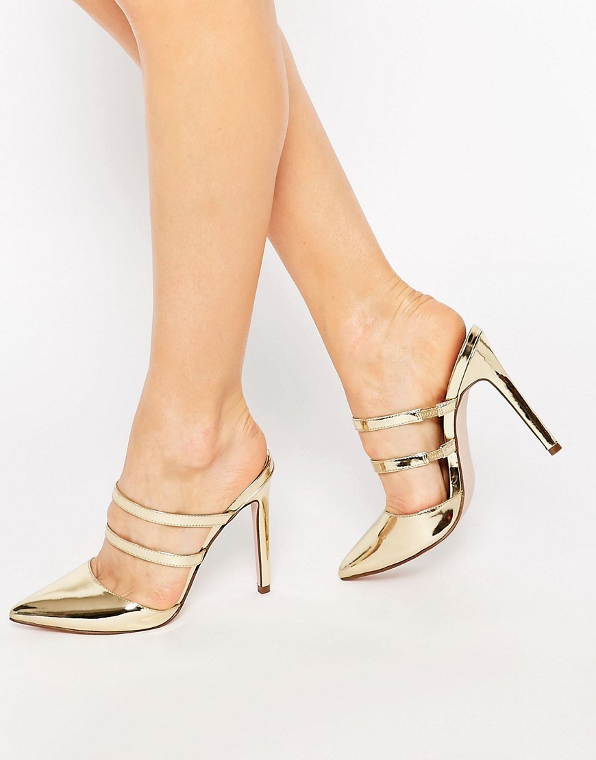 Platoon Pointed Mules Gold Metallic - predominant colour: gold; occasions: evening, occasion; material: faux leather; heel height: high; heel: stiletto; toe: pointed toe; style: mules; finish: metallic; pattern: plain; season: s/s 2016; wardrobe: event