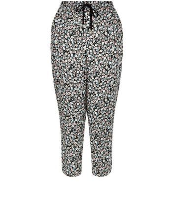Black Ditsy Floral Print Cropped Joggers - length: standard; style: tracksuit pants; waist: high rise; waist detail: belted waist/tie at waist/drawstring; secondary colour: white; predominant colour: black; occasions: casual, creative work; fibres: viscose/rayon - 100%; fit: tapered; pattern type: fabric; pattern: florals; texture group: jersey - stretchy/drapey; pattern size: big & busy (bottom); multicoloured: multicoloured; season: s/s 2016; wardrobe: highlight