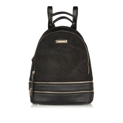 Womens Black Zip Backpack - predominant colour: black; occasions: casual; type of pattern: standard; style: rucksack; length: rucksack; size: standard; material: fabric; pattern: plain; finish: plain; season: s/s 2016; wardrobe: basic