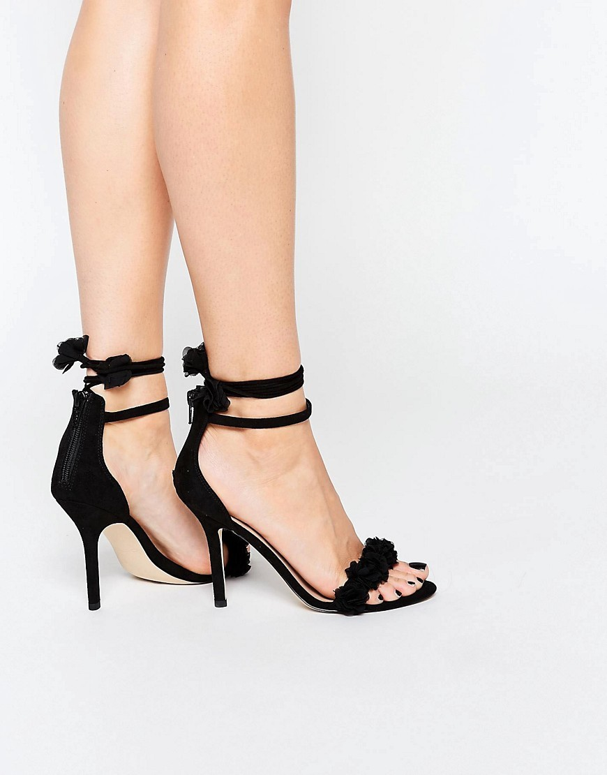 Silalia Black Lace Up Pompom Heeled Sandal Black - predominant colour: black; occasions: evening, occasion; heel height: high; ankle detail: ankle tie; heel: stiletto; toe: open toe/peeptoe; style: courts; finish: plain; pattern: plain; material: faux suede; season: s/s 2016; wardrobe: event