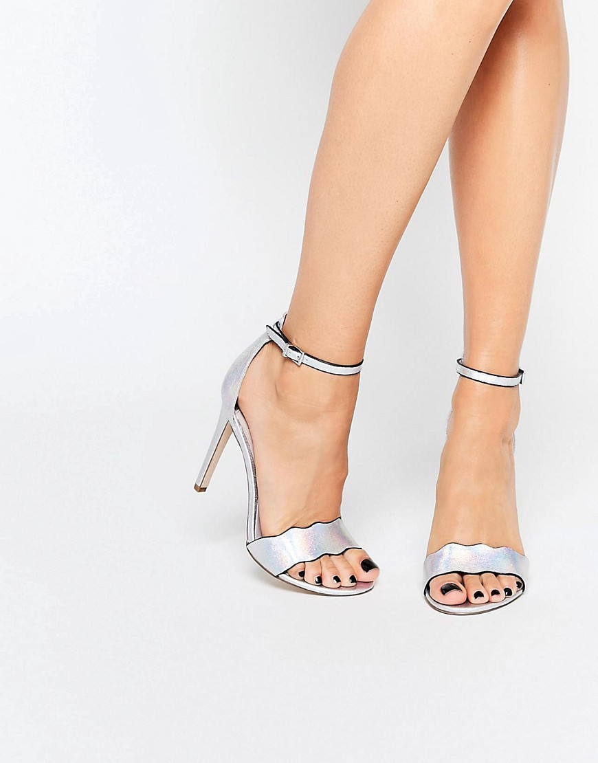 Leah Silver Wavy Heeled Sandals Silver - predominant colour: silver; occasions: evening, occasion; material: faux leather; heel height: high; ankle detail: ankle strap; heel: stiletto; toe: open toe/peeptoe; style: standard; finish: metallic; pattern: plain; season: s/s 2016; wardrobe: event