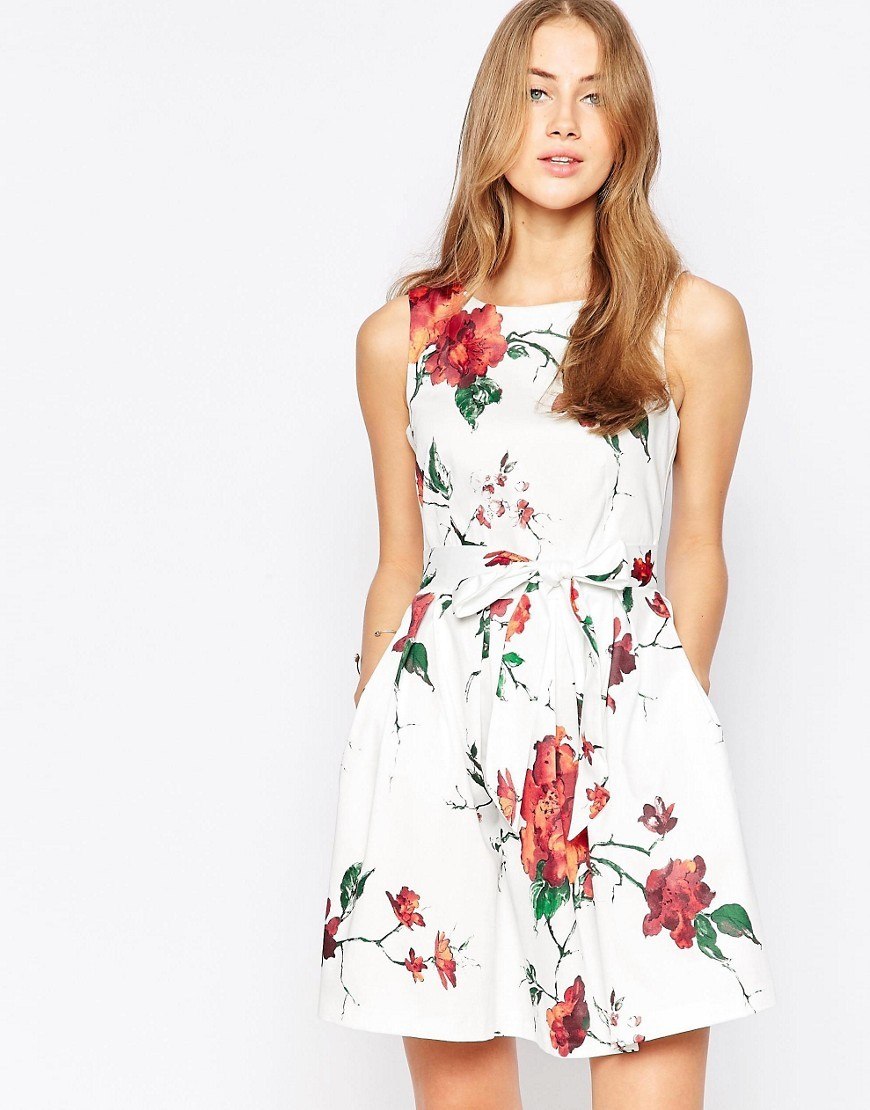 Closet Foral Bow Skater Dress White And Red - length: mid thigh; sleeve style: sleeveless; waist detail: belted waist/tie at waist/drawstring; predominant colour: white; secondary colour: true red; occasions: evening; fit: fitted at waist & bust; style: fit & flare; fibres: cotton - stretch; neckline: crew; sleeve length: sleeveless; pattern type: fabric; pattern: florals; texture group: jersey - stretchy/drapey; multicoloured: multicoloured; season: s/s 2016; wardrobe: event