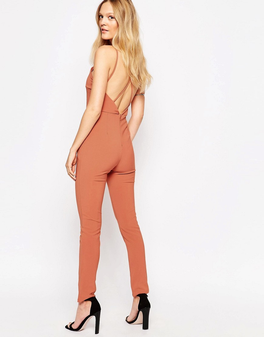 Strappy Back Jumpsuit Rust - length: standard; neckline: low v-neck; sleeve style: spaghetti straps; fit: tight; pattern: plain; predominant colour: terracotta; occasions: evening; fibres: polyester/polyamide - 100%; sleeve length: sleeveless; texture group: jersey - clingy; style: jumpsuit; pattern type: fabric; season: s/s 2016; wardrobe: event