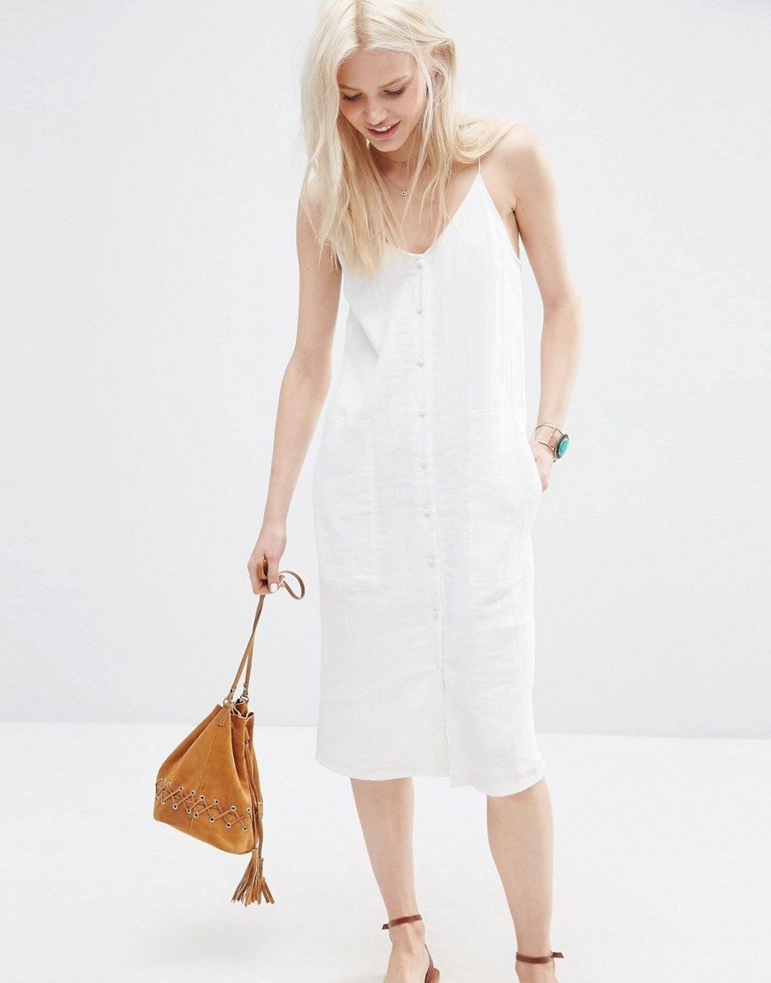 Sundress With Button Through Detail In Natural Fibre White - length: below the knee; neckline: low v-neck; pattern: plain; sleeve style: sleeveless; style: sundress; predominant colour: white; occasions: casual; fit: body skimming; fibres: polyester/polyamide - 100%; sleeve length: sleeveless; texture group: cotton feel fabrics; pattern type: fabric; embellishment: embroidered; season: s/s 2016; wardrobe: highlight