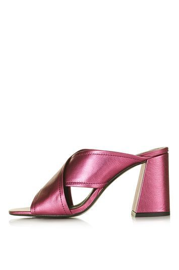 Riot Flared Mules - predominant colour: hot pink; occasions: evening, occasion; material: leather; heel height: high; heel: block; toe: open toe/peeptoe; style: mules; finish: metallic; pattern: plain; season: s/s 2016; wardrobe: event; trends: metallics