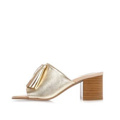 Womens Gold Leather Tassel Mules - predominant colour: gold; occasions: evening; material: leather; heel height: mid; heel: block; toe: open toe/peeptoe; style: mules; finish: metallic; pattern: plain; season: s/s 2016; wardrobe: event