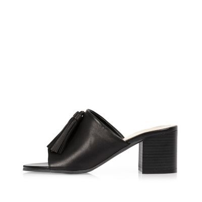 Womens Black Leather Tassel Mules - predominant colour: black; occasions: casual, holiday, creative work; material: leather; heel height: mid; heel: block; toe: open toe/peeptoe; style: mules; finish: plain; pattern: plain; season: s/s 2016; wardrobe: highlight