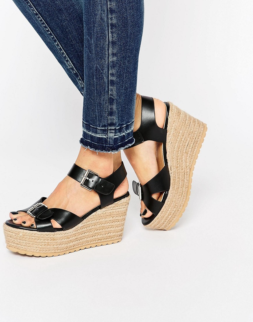Talking Point Wedge Sandals Black - predominant colour: black; occasions: casual; material: leather; heel height: high; heel: wedge; toe: open toe/peeptoe; style: standard; finish: plain; pattern: plain; shoe detail: platform; season: s/s 2016