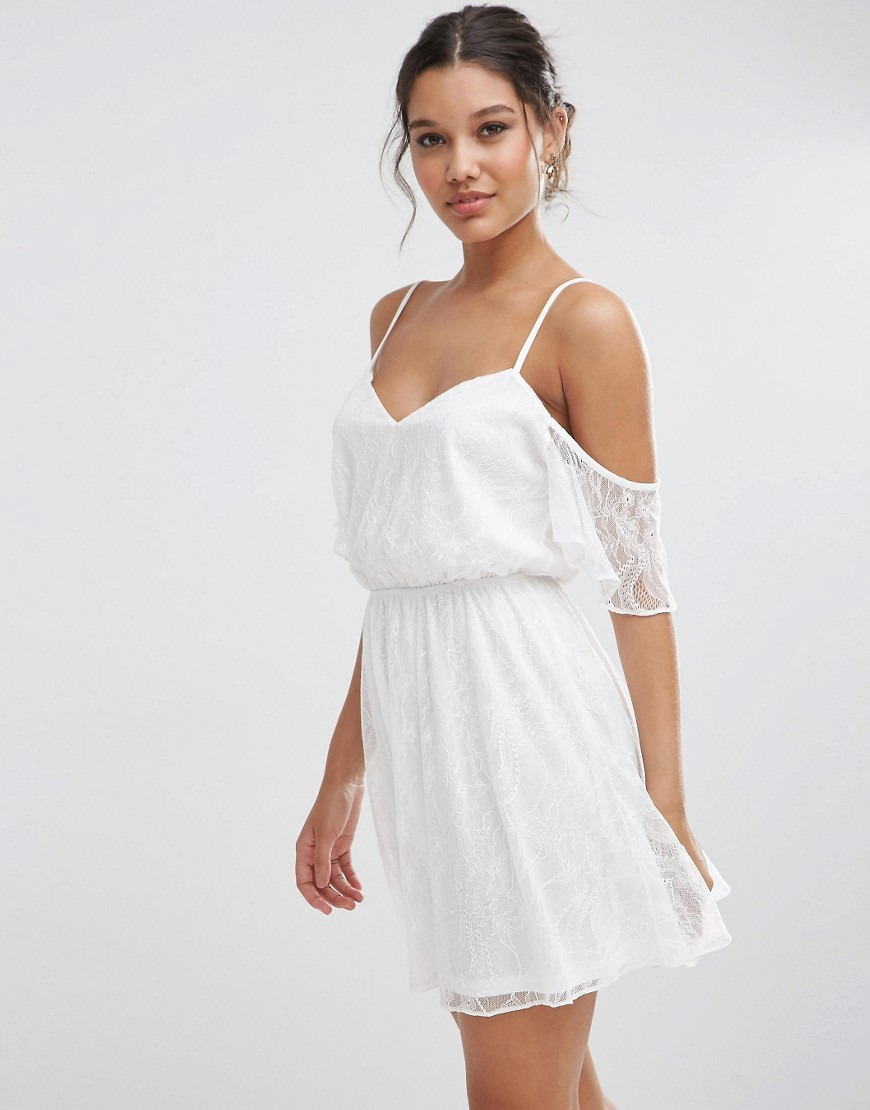 Lace Cold Shoulder Flutter Sleeve Mini Skater Dress White - length: mid thigh; neckline: low v-neck; fit: fitted at waist; style: sundress; predominant colour: white; occasions: evening; fibres: polyester/polyamide - 100%; shoulder detail: cut out shoulder; sleeve length: half sleeve; sleeve style: standard; pattern type: fabric; pattern size: standard; pattern: patterned/print; texture group: other - light to midweight; embellishment: lace; season: s/s 2016; wardrobe: event