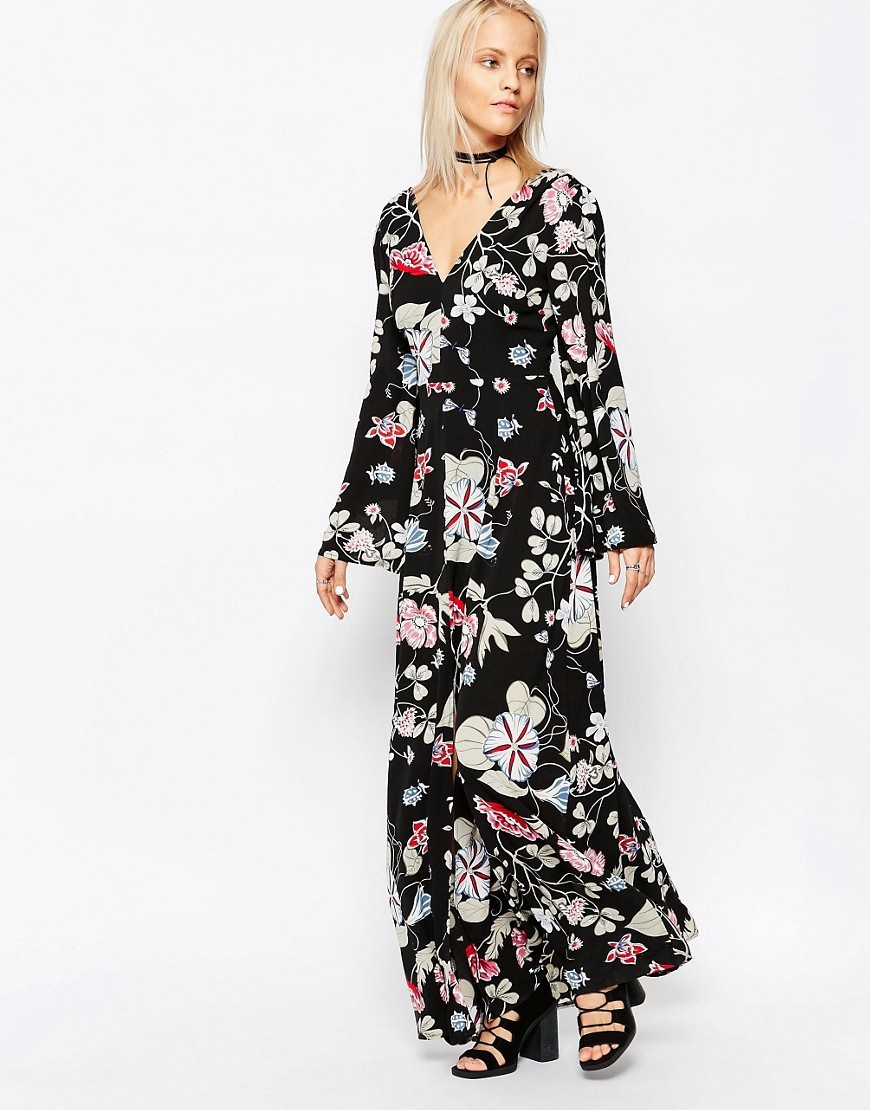 V Neck Maxi Dress Blk Oriental Floral - neckline: v-neck; sleeve style: bell sleeve; fit: fitted at waist; style: maxi dress; length: ankle length; secondary colour: pink; predominant colour: black; occasions: casual, holiday; fibres: polyester/polyamide - 100%; sleeve length: long sleeve; pattern type: fabric; pattern: patterned/print; texture group: other - light to midweight; multicoloured: multicoloured; season: s/s 2016; trends: vintage chic