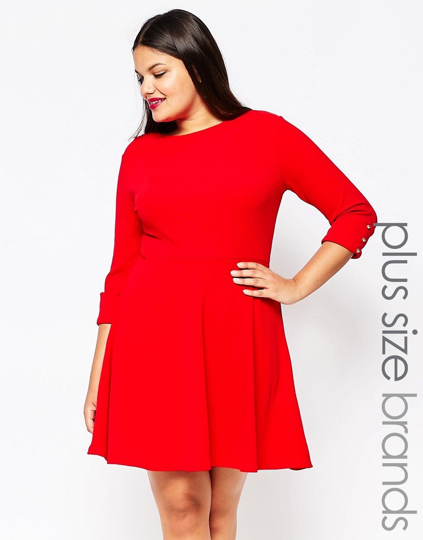 Plus Skater Dress With Button Sleeves Red - length: mid thigh; pattern: plain; waist detail: fitted waist; predominant colour: true red; fit: fitted at waist & bust; style: fit & flare; fibres: cotton - stretch; neckline: crew; hip detail: soft pleats at hip/draping at hip/flared at hip; sleeve length: 3/4 length; sleeve style: standard; pattern type: fabric; texture group: jersey - stretchy/drapey; occasions: creative work; season: s/s 2016