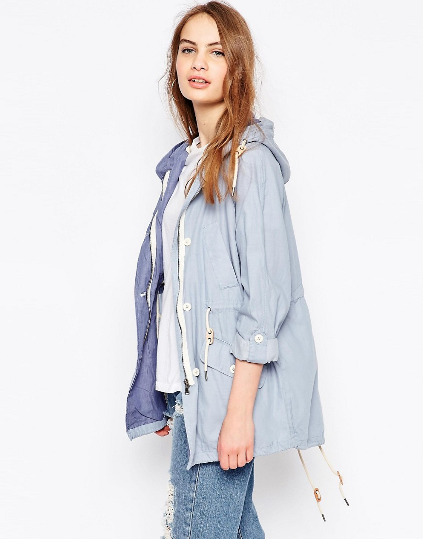Chambray Parka Light Blue - pattern: plain; length: below the bottom; fit: loose; style: parka; back detail: hood; collar: standard lapel/rever collar; predominant colour: pale blue; occasions: casual; fibres: cotton - 100%; waist detail: belted waist/tie at waist/drawstring; sleeve length: long sleeve; sleeve style: standard; texture group: cotton feel fabrics; collar break: medium; pattern type: fabric; season: s/s 2016; wardrobe: highlight