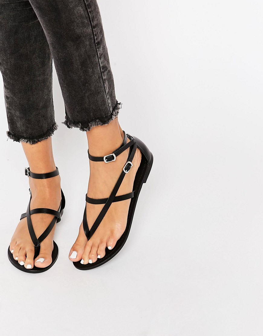 Forceful Leather Flat Sandals Black - predominant colour: black; occasions: casual, holiday; material: leather; heel height: flat; ankle detail: ankle strap; heel: block; toe: toe thongs; style: strappy; finish: plain; pattern: plain; season: s/s 2016; wardrobe: basic