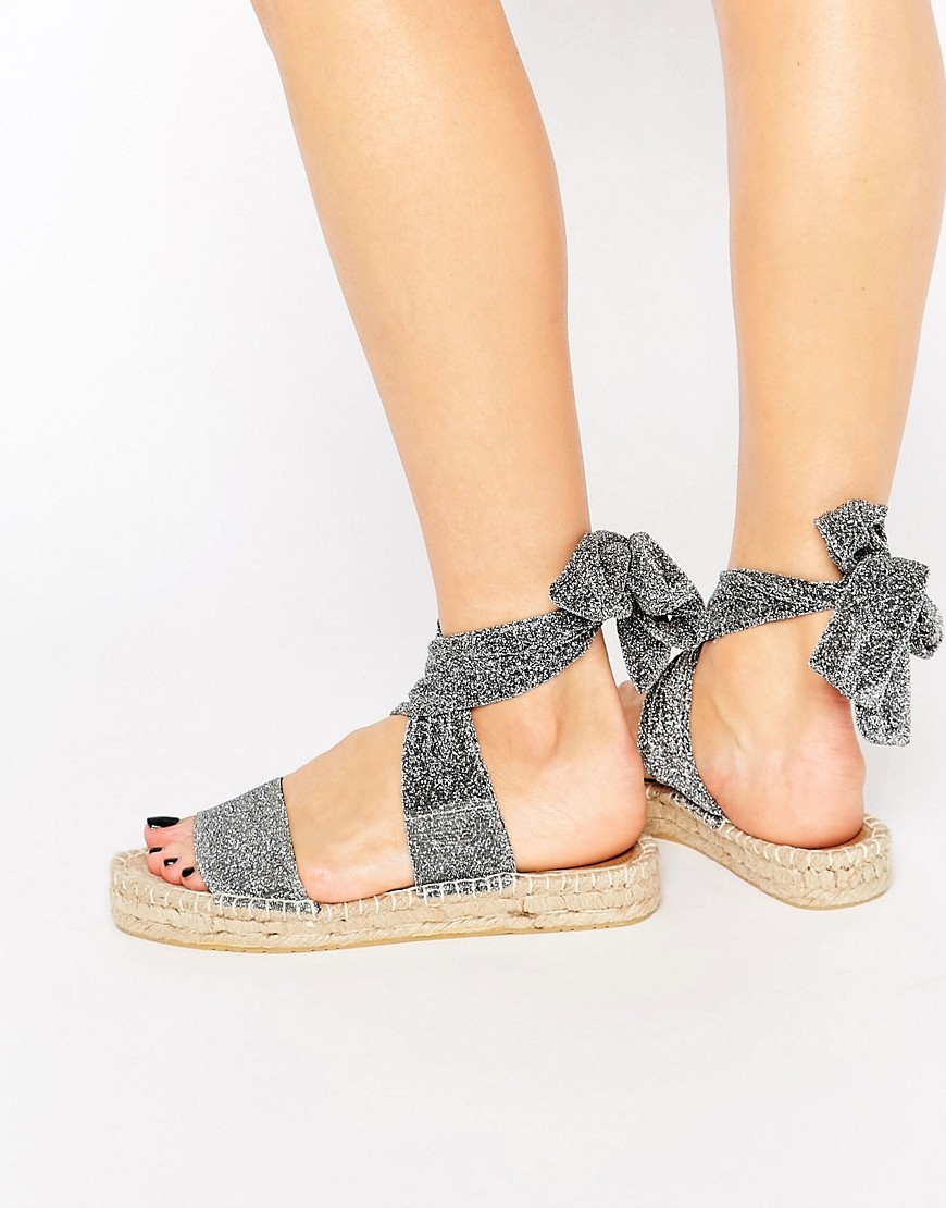 Jasmine Tie Leg Espadrille Sandals Silver Lurex - predominant colour: silver; occasions: casual, holiday; material: fabric; heel height: flat; ankle detail: ankle strap; heel: block; toe: toe thongs; style: standard; finish: plain; pattern: plain; shoe detail: platform; season: s/s 2016; wardrobe: basic