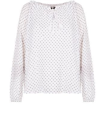 White Polka Dot Tie Front Blouse - neckline: round neck; sleeve style: dolman/batwing; style: blouse; predominant colour: ivory/cream; secondary colour: black; occasions: casual; length: standard; fibres: cotton - 100%; fit: body skimming; sleeve length: long sleeve; pattern type: fabric; pattern size: standard; pattern: patterned/print; texture group: other - light to midweight; season: s/s 2016
