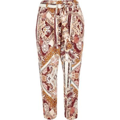 Womens Pink Paisley Print Tapered Trousers - style: peg leg; waist detail: belted waist/tie at waist/drawstring; waist: mid/regular rise; predominant colour: ivory/cream; secondary colour: burgundy; occasions: casual, creative work; length: ankle length; fibres: viscose/rayon - 100%; fit: tapered; pattern type: fabric; pattern: patterned/print; texture group: other - light to midweight; multicoloured: multicoloured; season: s/s 2016