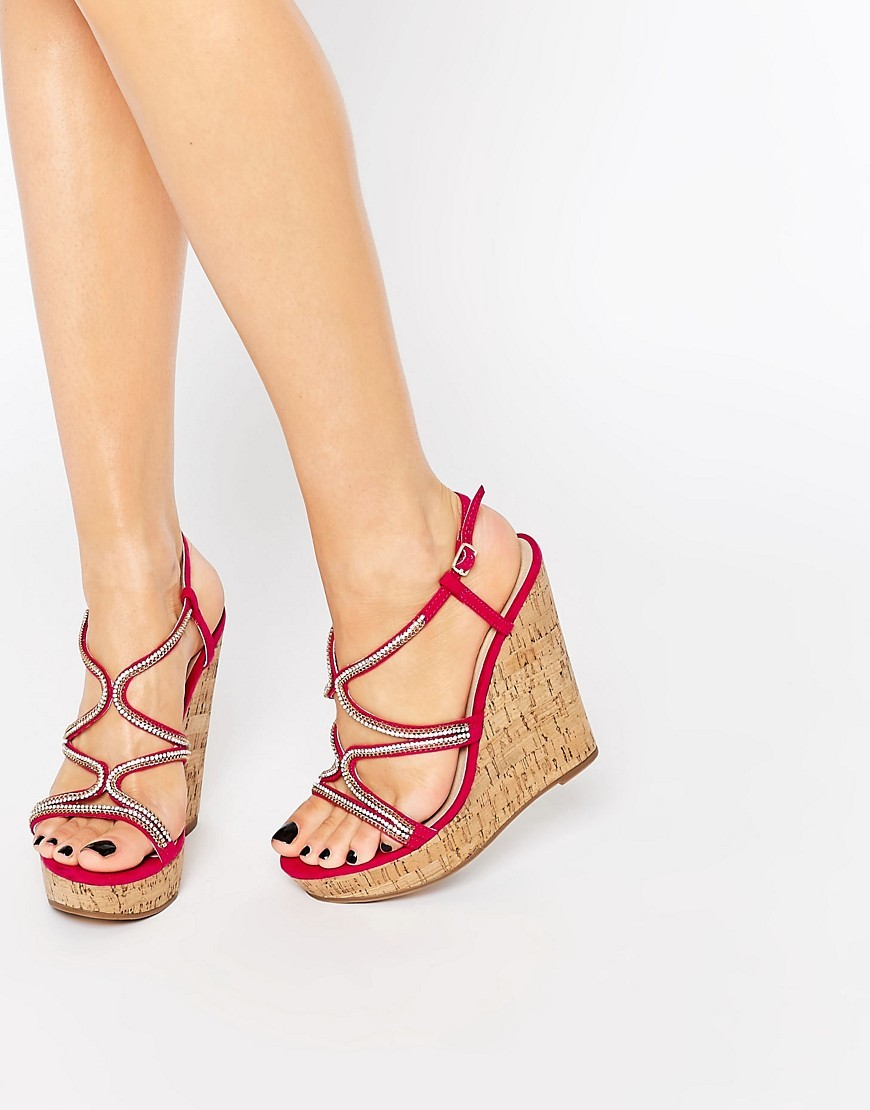 Terrific Embellished Wedge Sandals Fuscia - predominant colour: true red; occasions: casual, holiday; heel: wedge; toe: open toe/peeptoe; style: strappy; finish: plain; pattern: plain; heel height: very high; material: faux suede; shoe detail: platform; multicoloured: multicoloured; season: s/s 2016; wardrobe: highlight