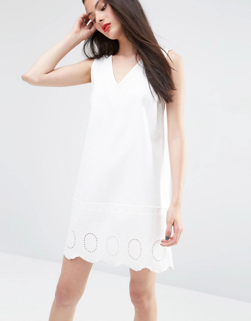Denim White Tunic Dress With Cutwork Hem White - style: tunic; length: mid thigh; neckline: v-neck; fit: loose; pattern: plain; sleeve style: sleeveless; predominant colour: white; occasions: casual, holiday, creative work; fibres: cotton - 100%; sleeve length: sleeveless; texture group: denim; pattern type: fabric; season: s/s 2016; wardrobe: basic