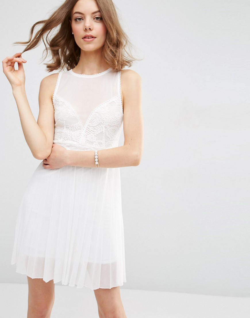 Mesh Lace Top Pleated Skirt Mini Dress Ivory - style: shift; neckline: round neck; pattern: plain; sleeve style: sleeveless; predominant colour: ivory/cream; length: just above the knee; fit: body skimming; fibres: polyester/polyamide - 100%; occasions: occasion; hip detail: structured pleats at hip; sleeve length: sleeveless; texture group: sheer fabrics/chiffon/organza etc.; pattern type: fabric; embellishment: lace; season: s/s 2016; wardrobe: event