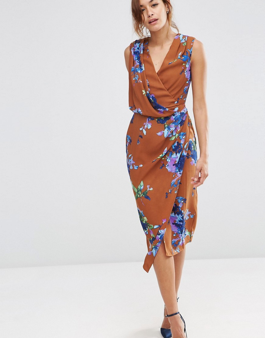 Drape Front Midi Dress In Brown Floral Multi - style: faux wrap/wrap; length: below the knee; neckline: v-neck; sleeve style: sleeveless; secondary colour: royal blue; predominant colour: camel; occasions: evening; fit: body skimming; fibres: polyester/polyamide - 100%; sleeve length: sleeveless; pattern type: fabric; pattern size: big & busy; pattern: florals; texture group: jersey - stretchy/drapey; multicoloured: multicoloured; season: s/s 2016; wardrobe: event