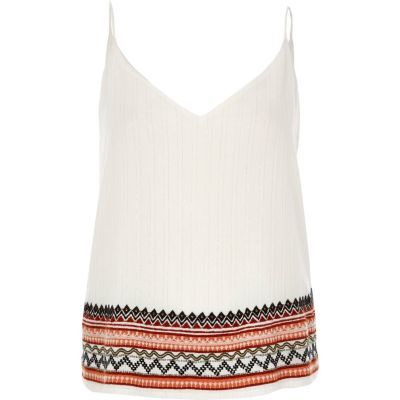 Womens Cream Embroidered Hem Cami Top - neckline: low v-neck; sleeve style: spaghetti straps; style: camisole; predominant colour: white; secondary colour: bright orange; occasions: casual; length: standard; fibres: cotton - 100%; fit: body skimming; sleeve length: sleeveless; texture group: cotton feel fabrics; pattern type: fabric; pattern size: light/subtle; pattern: patterned/print; embellishment: embroidered; multicoloured: multicoloured; season: s/s 2016; wardrobe: highlight