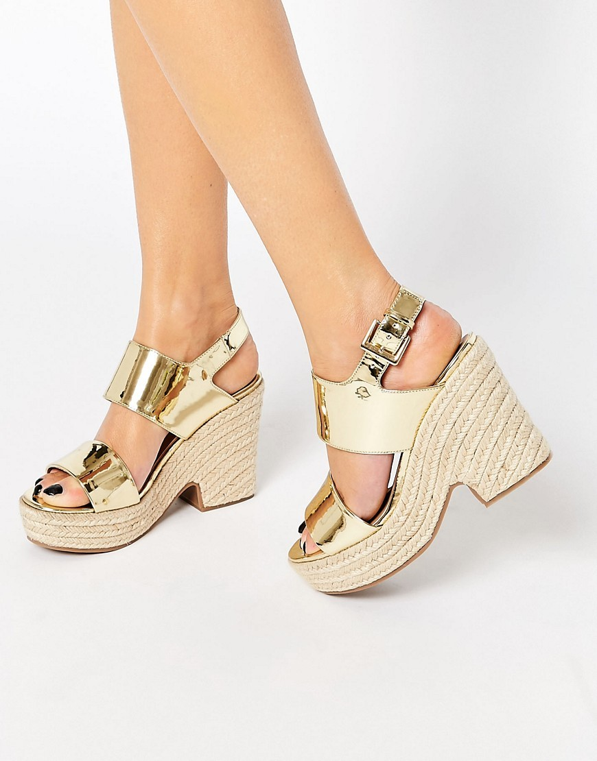 Tell All Espadrille Wedge Sandals Gold - predominant colour: gold; occasions: casual; material: faux leather; heel height: high; ankle detail: ankle strap; heel: wedge; toe: open toe/peeptoe; style: standard; finish: metallic; pattern: plain; shoe detail: platform; season: s/s 2016