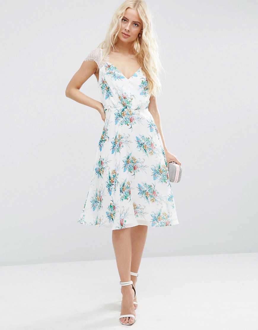 Kate Lace Midi Dress In White Floral Multi - length: below the knee; neckline: v-neck; sleeve style: capped; style: sundress; predominant colour: white; secondary colour: turquoise; occasions: evening; fit: body skimming; fibres: polyester/polyamide - 100%; sleeve length: short sleeve; texture group: lace; pattern type: fabric; pattern size: big & busy; pattern: patterned/print; embellishment: lace; shoulder detail: sheer at shoulder; multicoloured: multicoloured; season: s/s 2016; wardrobe: event; embellishment location: shoulder