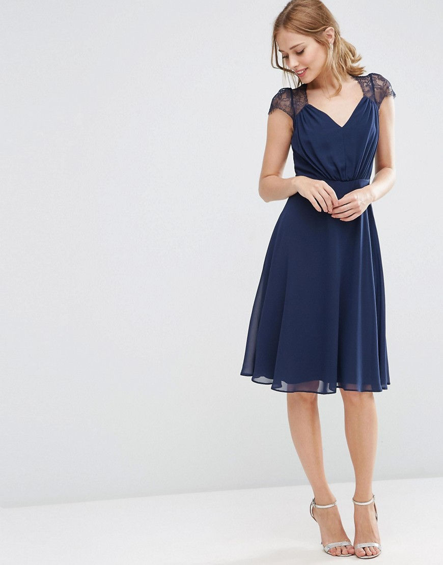 Kate Lace Midi Dress Navy - length: below the knee; neckline: low v-neck; sleeve style: capped; pattern: plain; shoulder detail: contrast pattern/fabric at shoulder; predominant colour: navy; occasions: evening, occasion; fit: fitted at waist & bust; style: fit & flare; fibres: polyester/polyamide - 100%; sleeve length: short sleeve; texture group: sheer fabrics/chiffon/organza etc.; pattern type: fabric; embellishment: lace; season: s/s 2016