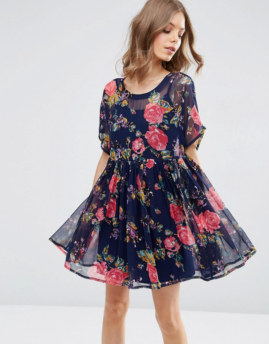 Smock Dress In Rose Print Floral Print - style: smock; length: mid thigh; fit: loose; secondary colour: pink; predominant colour: navy; occasions: evening; fibres: polyester/polyamide - 100%; neckline: crew; sleeve length: short sleeve; sleeve style: standard; texture group: sheer fabrics/chiffon/organza etc.; pattern type: fabric; pattern size: big & busy; pattern: florals; multicoloured: multicoloured; season: s/s 2016; wardrobe: event