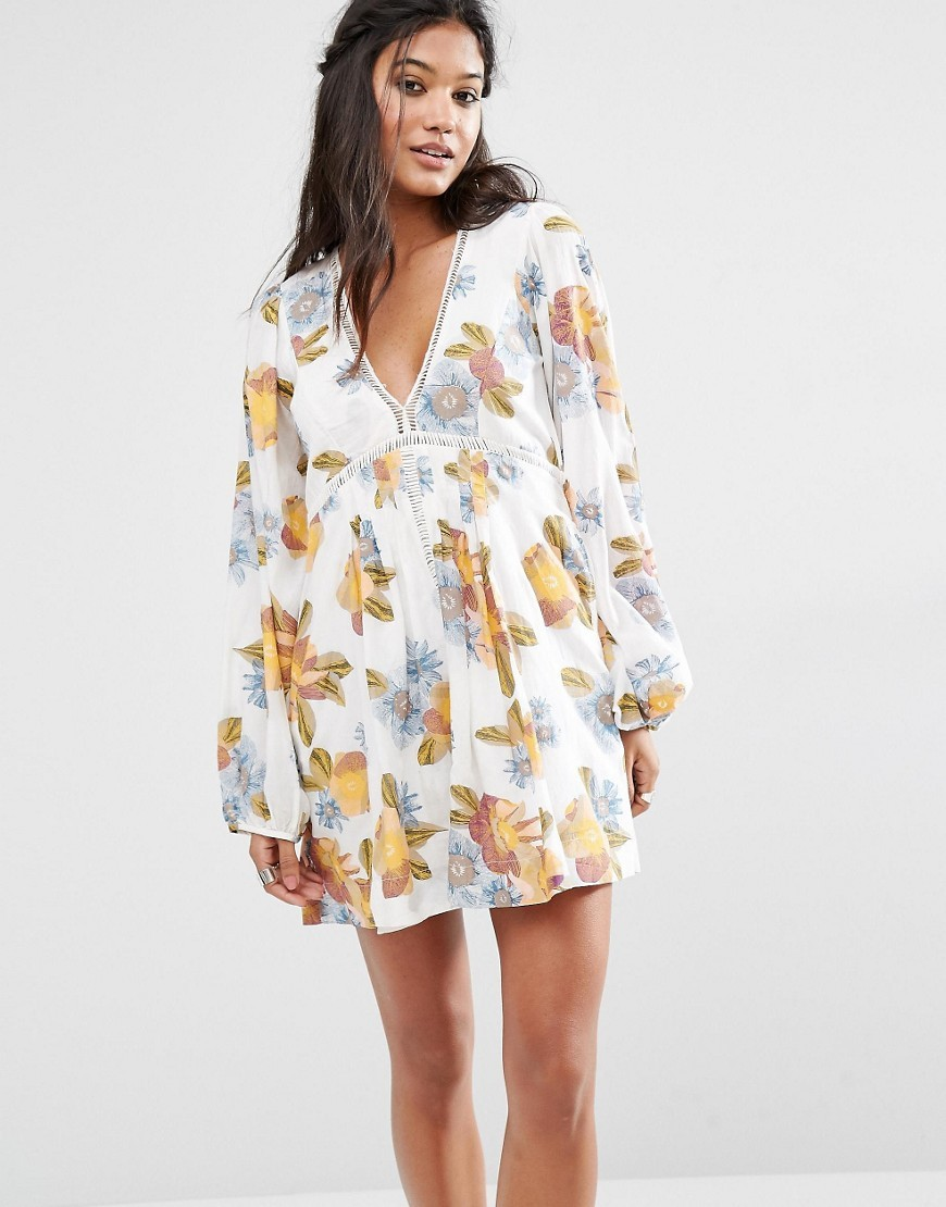 Strawberry Fields Smock Dress In Floral Print Ivory Combo 1006 - style: smock; length: mid thigh; neckline: low v-neck; fit: loose; predominant colour: ivory/cream; secondary colour: gold; occasions: casual; sleeve length: long sleeve; sleeve style: standard; pattern type: fabric; pattern size: big & busy; pattern: florals; texture group: jersey - stretchy/drapey; fibres: viscose/rayon - mix; multicoloured: multicoloured; season: s/s 2016