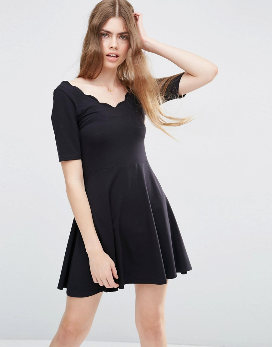 Mini Skater Dress With Scallop Neckline Black - length: mid thigh; neckline: v-neck; pattern: plain; predominant colour: black; occasions: evening; fit: fitted at waist & bust; style: fit & flare; fibres: cotton - stretch; sleeve length: short sleeve; sleeve style: standard; pattern type: fabric; texture group: jersey - stretchy/drapey; season: s/s 2016; wardrobe: event