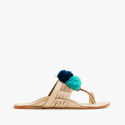 Figue® Lolita Sandals - predominant colour: ivory/cream; secondary colour: navy; material: leather; heel height: flat; heel: standard; toe: toe thongs; style: flip flops; occasions: holiday; finish: plain; pattern: plain; embellishment: pompom; season: s/s 2016; wardrobe: highlight