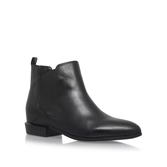 Doloris - predominant colour: black; occasions: casual, creative work; material: leather; heel height: flat; heel: standard; toe: round toe; boot length: ankle boot; finish: plain; pattern: plain; style: chelsea; season: s/s 2016; wardrobe: basic